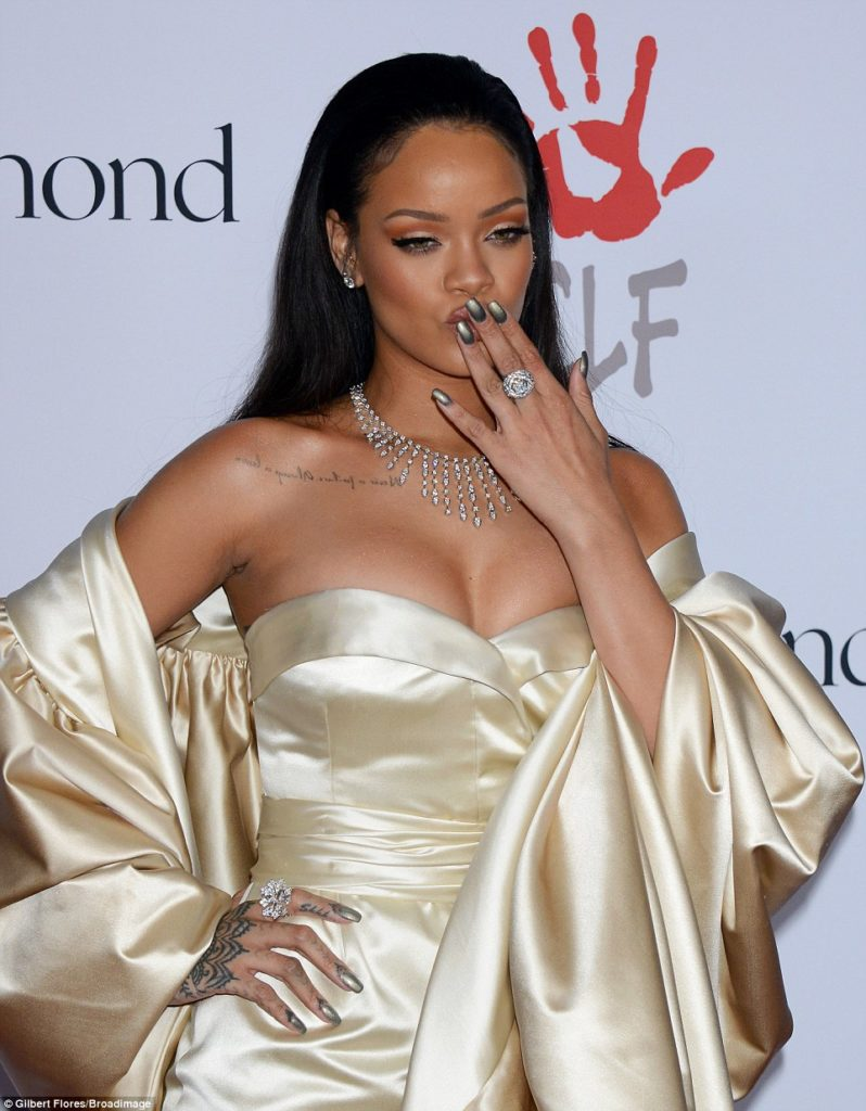 Rihanna Hot in a  Golden Christian Dior Gown
