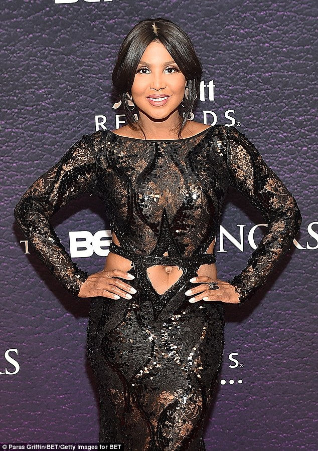 Toni Braxton puts her belly on display in a Black Shiny  ultra-sheer cut-out