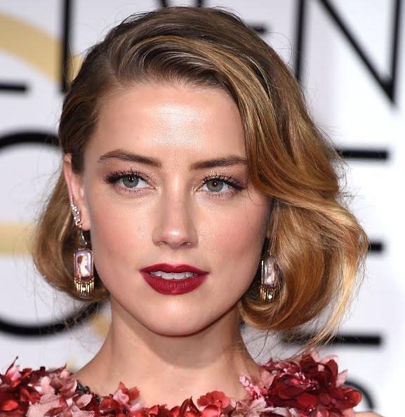 Amber Heard all smiles as she wins a court Order Restraining her Estranged Husband Johnny Depp