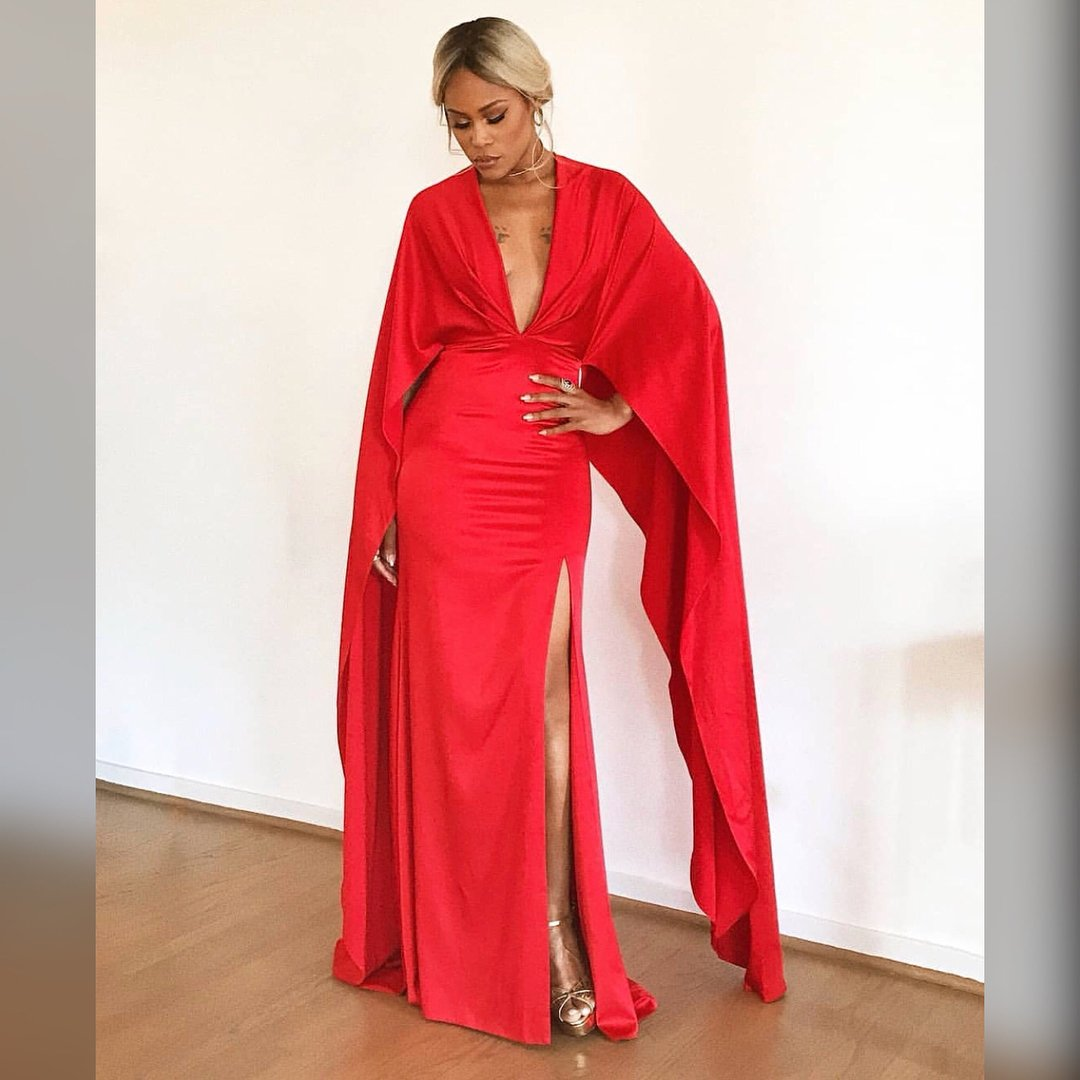 Feminist Rapper Eve is red hot in cleavage-baring dress