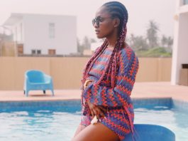 Singer Simi rocks Ankara bum-shot and braided Hairstyle as she relax by the Pool Side