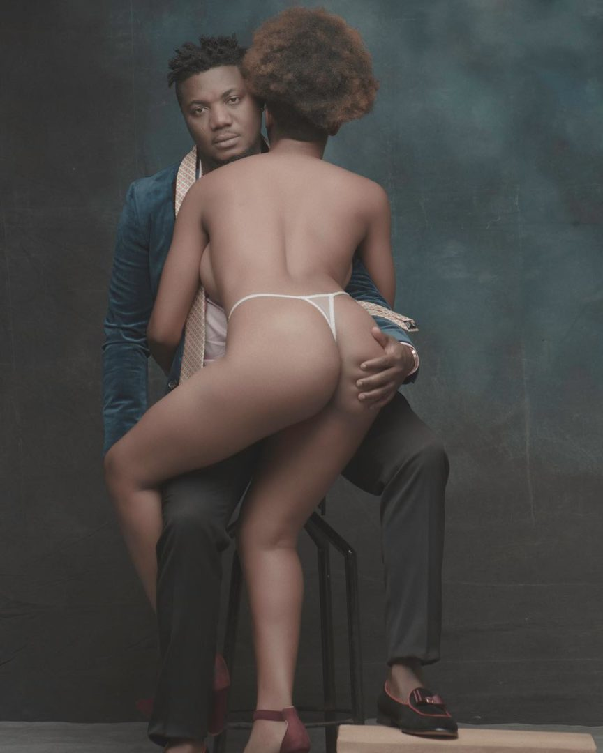 Nigerian Rapper CDQ Poses With Lady In G-String To Celebrate Christmas