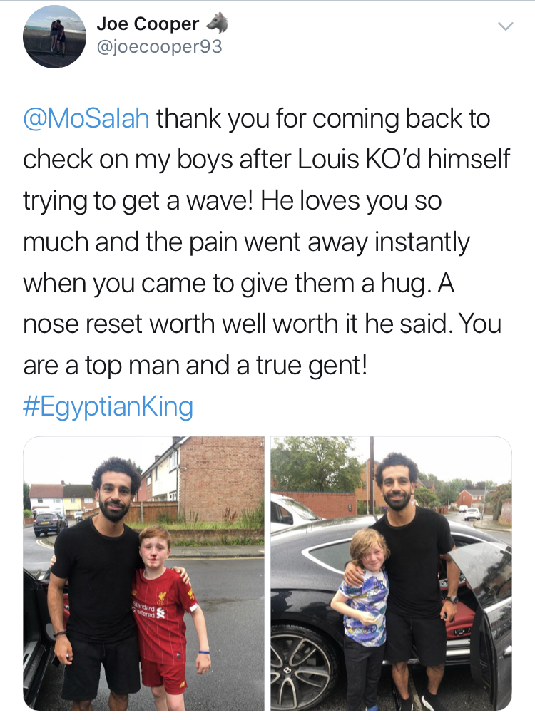 Mo Salah takes pictures with a young boy after he passed out trying to catch his car