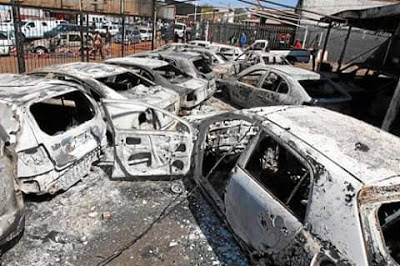 XENOPHOBIA ATTACK: Nigeria car dealer cries as he watches all his cars burn down into ashes