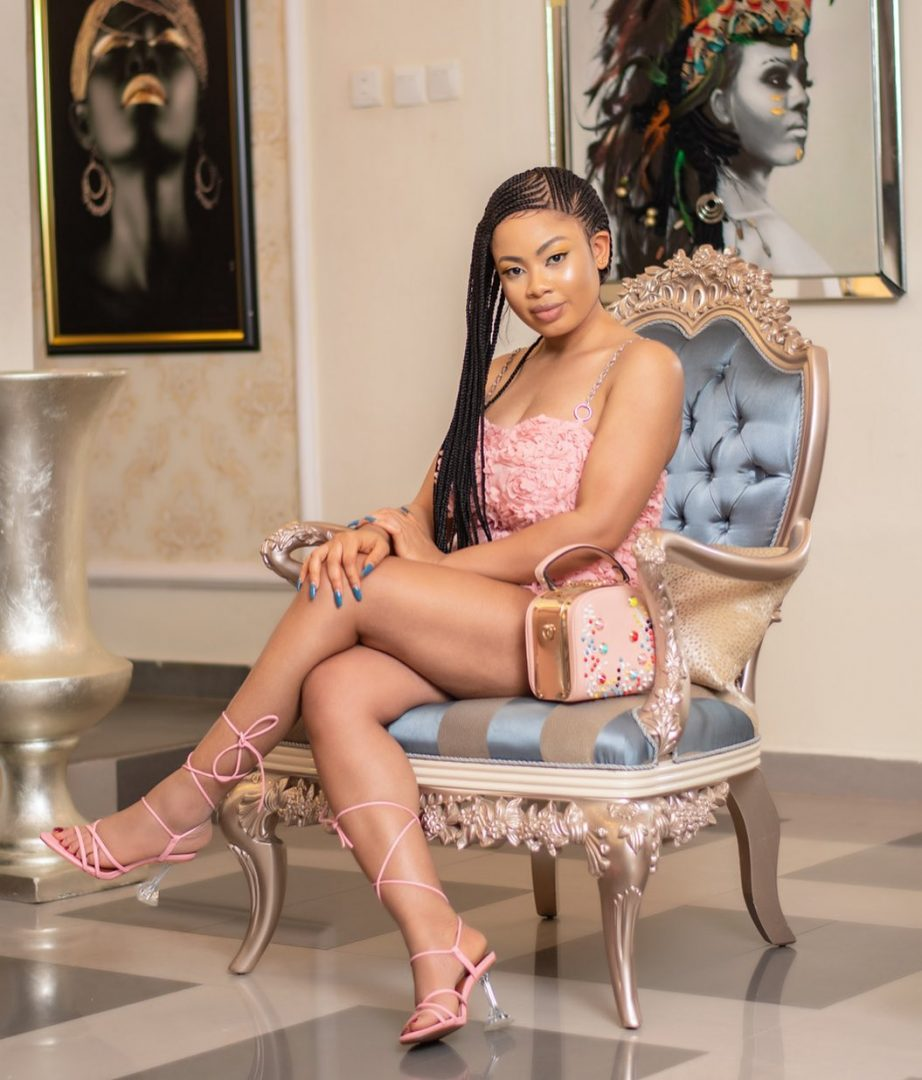 Feels good to be back,as Nina Ivy rocks a Short Pink Dress for the New year